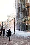 Historical pedestrian Arbat street in Moscow. MOSCOW, RUSSIA - JANUARY 19, 2014: tourists on Arbat street in winter morning. Arbat has existed since the 15th Stock Images