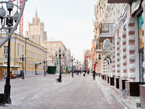 Historical pedestrian Arbat street in Moscow. MOSCOW, RUSSIA - JANUARY 19, 2014: view of Ministry of Foreign Affairs building over Arbat street in Moscow. Arbat Royalty Free Stock Image