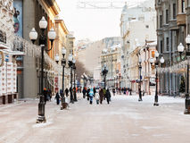 Historical pedestrian Arbat street in Moscow. MOSCOW, RUSSIA - JANUARY 19, 2014: view of Arbat street and tourists in Moscow. Arbat has existed since the 15th Stock Images