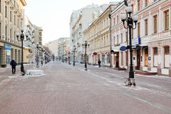 Historical pedestrian Arbat street in Moscow. MOSCOW, RUSSIA - JANUARY 19, 2014: view of Arbat street in Moscow in winter morning. Arbat has existed since the Royalty Free Stock Photography