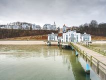 Historical pier and the resort of Sellin on Ruegen island. At moody sunset, Germany. 27th of January 2018 royalty free stock photography