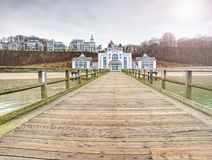 Historical pier and the resort of Sellin on Ruegen island. At moody sunset, Germany. 27th of January 2018 stock photography