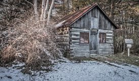 Historical log cabin with open front door stock image for Privately owned cabins in the smoky mountains