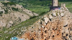 The top of the cliff. The historical place of the Crimea, the Genoese Chambalo tower of the 15th century. The camera moves from the foot of the cliff to the top stock footage