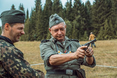 Historical reconstruction second world war. A German soldier hol Stock Photo