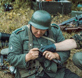 Historical reconstruction second world war. German soldiers insp Stock Photos