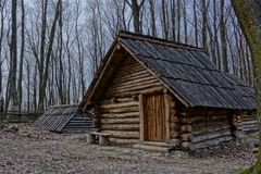 Historical reconstruction of wooden clapboard medieval cabin in hillfort Bojná, Slovakia. Stock Photos