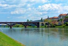 Bridge over river Drava in Maribor. Historical red bridge Glavni most in Maribor city in Slovenia stock images