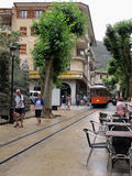 Historical red cable car Tranvia is passing cityscape of Soller Stock Photos