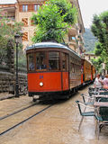 Historical red cable car Tranvia is passing cityscape of Soller Royalty Free Stock Photo