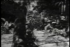 Historical reenactment of soldiers attacking enemy headquarters on tropical island stock video footage