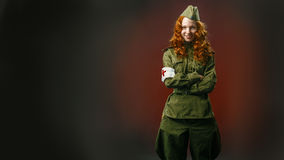 Historical reenactment of soviet union army by pretty girl Royalty Free Stock Photos