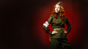 Historical reenactment of soviet union army by pretty girl Royalty Free Stock Photography