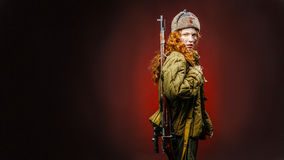 Historical reenactment of soviet union army by pretty girl with Royalty Free Stock Photography
