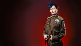 Historical reenactment of soviet union army by pretty woman Royalty Free Stock Photo
