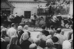 Historical reenactment World War II - armed peasants on horseback stock video footage