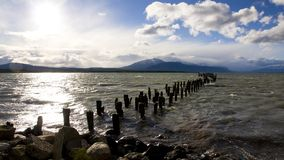 The historical remains of the pier on a lake in Pu Stock Photography