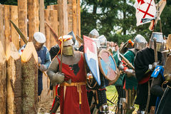 Historical restoration of knightly fights. The siege of wooden f Stock Images