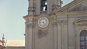 Cathedral Of St Paul Malta. Historical restored footage of Malta from 1970: Ancient Mdina Cathedral Of St. Paul of 1700, main gate with clock towers. founded in stock video