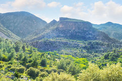The historical rock. The beautiful landscape with rock-cut tombs on the slope of the rock, Pinara, Turkey Royalty Free Stock Photos