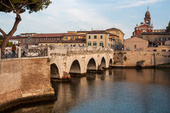 Historical roman Tiberius' bridge. Over Marecchia river, Rimini, Italy Stock Photography