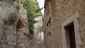 Historical Roman village in Eze. Architextural village made with stone in Eze France. Tilting shot of historical Roman town alleyway stock video footage