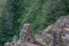 Historical ruins of an Inca town in the Andes. Ancient stone ruins of an Inca town on the Inca Trail in the Andes mountains. Cusco. Peru. South America. No stock image