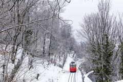 The historical Sassi – Superga rack tramway in winter time. Tu. The historical Sassi – Superga  Turin-Italy rack tramway in winter time.The rack tramway is Stock Photos