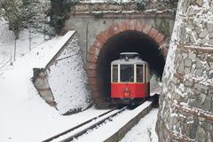 The historical Sassi – Superga rack tramway in winter time-. T. The historical Sassi – Superga  Turin-Italy rack tramway in winter time.The rack tramway is Royalty Free Stock Photography