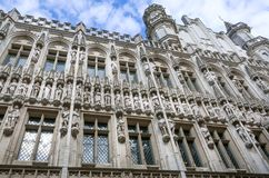 Historical sculptures in Gothic style and tower of the 15th century Town Hall, UNESCO World Heritage Site in Brussels. Historical sculptures in Gothic style and stock photography