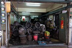 The historical second hand car parts store. The front of a roadside historical second hand car parts store in Taipei.The parts of scrap car will be checked Royalty Free Stock Images