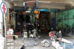 The historical second hand car parts store. The front of a roadside historical second hand car parts store in Taipei.The parts of scrap car will be checked Royalty Free Stock Image