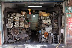 The historical second hand car parts store. The front of a roadside historical second hand car parts store in Taipei.The parts of scrap car will be checked Stock Photo