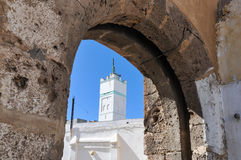 Historical setting - Azemmour. Stone arch frames the Kasbah of Azemmour - Morocco Royalty Free Stock Photography