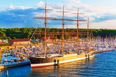 Historical ship in Travemunde, Germany. Scenic summer evening view of historical ship Passat in the Old Town pier of Travemunde, Germany Stock Photos