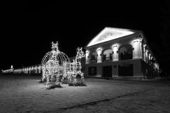 Historical shopping arcades Gostiny Dvor at night. Fairy-tale carriage with horses glowing lights of a garland. Suzdal, Vladimir Region, Russia. Gold ring Royalty Free Stock Image
