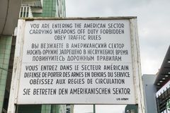 Historical sign at Checkpoint Charlie in Berlin. BERLIN - AUGUST 21, 2017: Historical sign at Checkpoint Charlie on August 21, 2017 in Berlin, Germany. The name stock photos