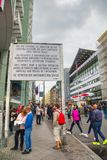 Historical sign at Checkpoint Charlie in Berlin. BERLIN - AUGUST 21, 2017: Historical sign at Checkpoint Charlie on August 21, 2017 in Berlin, Germany. The name Royalty Free Stock Photos