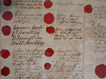 Red wax seals with historic signatures. An original parchment with the signature of former consuls and their individual wax seals. Medieval times in Germany Royalty Free Stock Photography