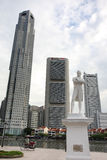 Historical Singapore. SINGAPORE - AUGUST 21, 2010: The statue of Sir Stamford Raffles (the founder of Singapore) at the site where he first landed in the island Royalty Free Stock Photo