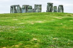 Historical site Stonehenge with cloudy sky. Historical site and world heritage Stonehenge with cloudy sky, United Kingdom stock photography