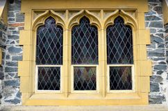 Historic Church Window. Historical 1869 St Peters Church constructed of local quarried Otago schiste stone Queenstown Otago New Zealand stained glass window Stock Photos