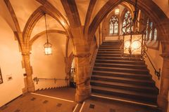 Historical stairs inside gothic style New Town Hall, Neues Rathausbuilt in 1908. Munich. MUNICH, GERMANY - NOVEMBER 17, 2017: Historical stairs inside gothic Royalty Free Stock Image