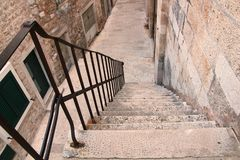Historical stairs. Stone`s stairs with iron fence in Vodice royalty free stock photos