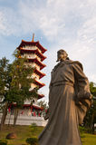 Historical statue and pagoda Royalty Free Stock Photos
