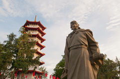 Historical statue and pagoda Royalty Free Stock Image