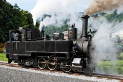 Historical steam engine on tracks  Stock Photography