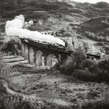 Historical Steam Train is crossing a Viaduct Stock Photography
