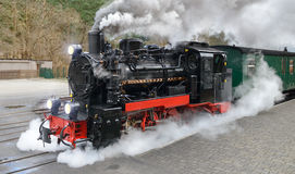 Historical steam train on Rugen in Germany. Historical steam train on end station in Gohren, island Rugen, Germany Stock Photos