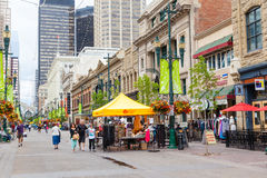 Historical Stephen Avenue in Downtown Calgary. Сalgary, Canada - June 18, 2016: Tourists and Calgarians alike stroll along Stephen Avenue Walk, a popular and Stock Images